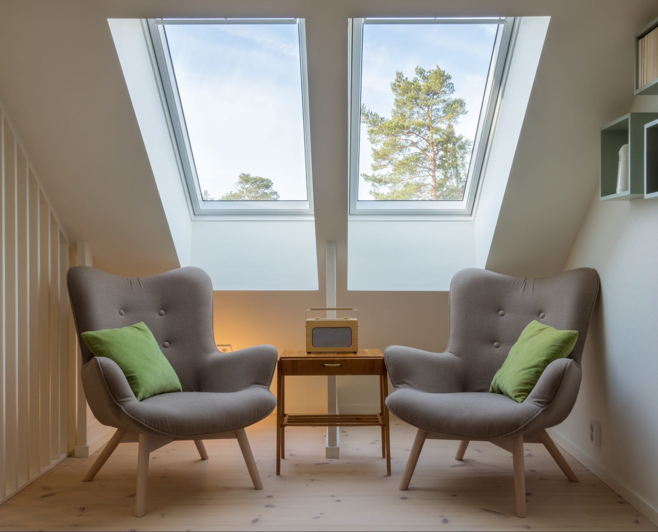 Solatube skylight in a common area of a house with chairs.